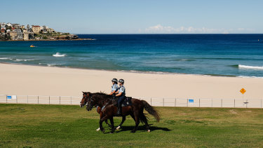 Mounted police patrolling an empty Bondi Beach.