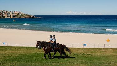 Mounted police patrolling an empty Bondi Beach.
