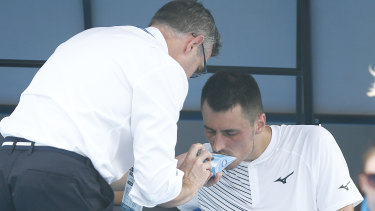 Australian Bernard Tomic using inhaler medication during his match on Tuesday.
