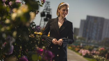 Actress Bella Heathcote, who will be a special guest of the Victoria Racing Club on Derby Day, with Flemington's famous roses.