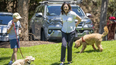 Premier Annastacia Palaszczuk with her dog Winton and her nephew Harry and his dog Oakey before a press conference at Rocks Riverside Park in Brisbane on Sunday.