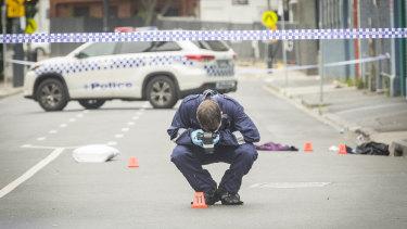 An officer photographs evidence left at the scene.