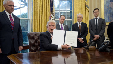 Donald Trump holds his executive order to withdraw the US from the Trans-Pacific Partnership in January last year, ending the US's decades-old tilt toward free-trade agreements.