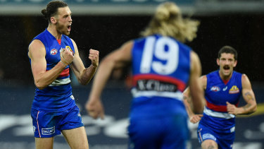 Lachie Young of the Bulldogs celebrates a goal.
