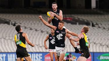 Mark of a champion: Carlton's Mitch McGovern rises high to take a grab.