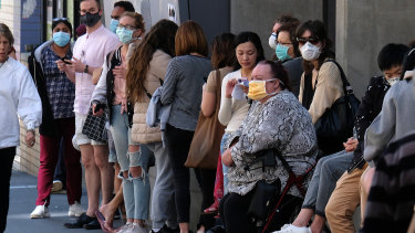 People wait outside a coronavirus screening clinic this week.
