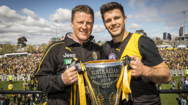 Damien Hardwick and Trent Cotchin with the premiership cup on Sunday.