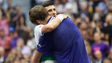Djokovic and Medvedev embrace after the US Open men's final, which the Russian won in straight sets.