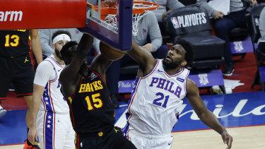 Hawks big man Clint Capela dunks over Philadelphia opponent, and the NBA's MVP runner-up, Joel Embiid.