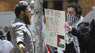 A man wearing a yarmulke, left, confronts one of about two dozen demonstrators protesting against the US embassy move on Monday.