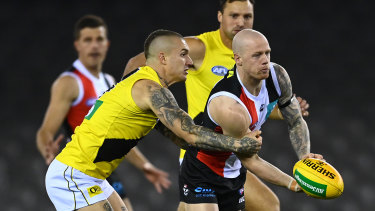 Dustin Martin, left, tackles Zak Jones, right, during the Tigers' round four loss to St Kilda last year.