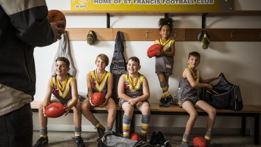 Members of the St Francis Football Club - Ethan (12), Maxwell (11), Samuel (9), Mya (8) and Kyle (12) are looking forward to a return to local footy this weekend.