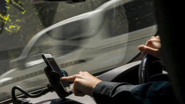 The National Transport Commission says road rules have not kept pace with technology.