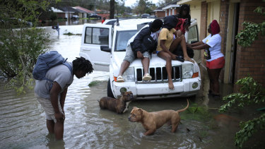 Residents wait to be rescued in LaPlace, Louisiana, after Hurricane Ida smashed through the state.