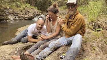 Amanda Eller with searches Javier Cantellops, left, and Chris Berquist, shortly after she was found.