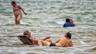 Seeking reprieve from the heat at Port Melbourne beach.