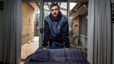 Labourer and masseur Jarred Webb who is working two jobs to get by.