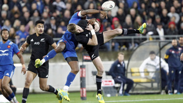 Controversial: All Black Jordie Barrett, right, and France's Benjamin Fall collide in the incident which saw the Frenchman sent off.