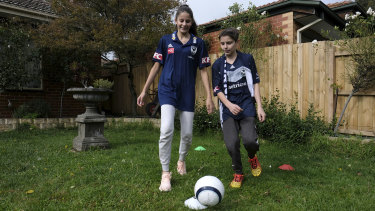 Nathalia Candiloro and brother Marco take part in Melbourne Victory's remote learning activities at home in Box Hill.
