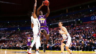 Jae-Sean Tate drives to the basket against Adelaide on Saturday night.
