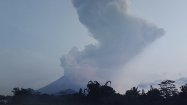 Mount Merapi spews volcanic material into the air in Sleman, Indonesia.