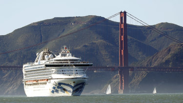 The Grand Princess cruise ship passes the Golden Gate Bridge as it arrives.