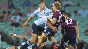 Power play: Israel Folau drives back Tate McDermott in the tackle.