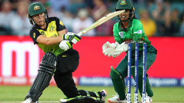 Alyssa Healy takes to the Bangladesh bowling attack in Canberra on Thursday night.
