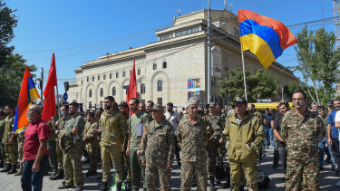 The Armenian government declared martial law on Sunday and mobilised service personnel and volunteers to set off for Nagorno-Karabakh.