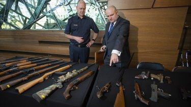Assistant minister for customs Jason Wood with with Senior Sergeant Steve Farrar after announcing the gun amnesty.