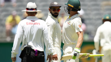 Virat Kohli and Tim Paine colliding during the 2018 Test series.