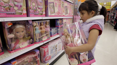 Yvette Ibarra holds a Dancing Princess Barbie doll while shopping at a toy store in Monrovia, California.