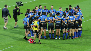 Better together: Force players form a huddle after their win over the Reds on Friday night.