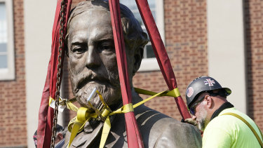 Crews remove the torso of Confederate general Robert E. Lee from Monument Avenue in Richmond, Virginia, on Wednesday.