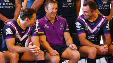 Storm coach Craig Bellamy with Cameron Smith and Billy Slater.