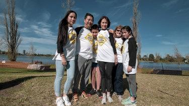 Maeve Luu, Louis Luu, Eamon Luu, Natasha Cook, Heather Cook and Eilidh Luu during the 'Shine a Light' road safety walk at Albert Park, on Sunday