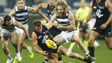 Patrick Cripps of the Blues is tackled by Cameron Guthrie of the Cats during the round 3 AFL match between the Geelong Cats and the Carlton Blues at GMHBA Stadium on June 20, 2020 in Geelong,