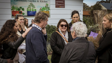 Minister for Women Natalie Hutchins meets Samantha Fraser's father Trevor (left) and Cowes residents on Saturday.