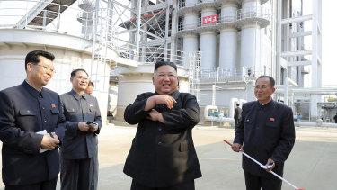 Kim Jong-un, centre, visits a fertiliser factory in South Pyongan, near Pyongyang, North Korea, on Friday.