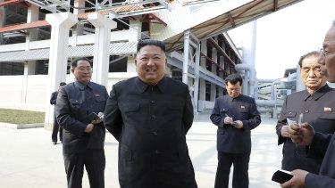 North Korean leader Kim Jong-un, centre, visits a fertiliser factory in South Pyongan, near Pyongyang, North Korea.