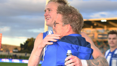 Jaidyn Stephenson and David Noble celebrate North Melbourne's win over the Gold Coast.
