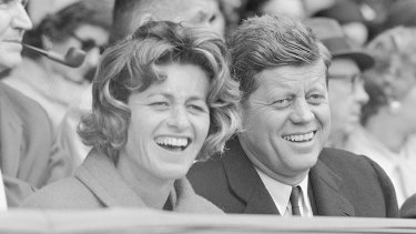 Jean Kennedy Smith and her brother John F. Kennedy watch an opening day baseball game at Griffith Stadium in Washington in 1961.