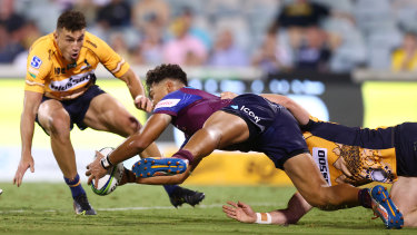 Jordan Petaia scores a try against the Brumbies in round four.