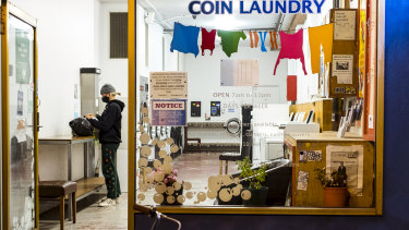 A Melbourne resident takes advantage of the curfew lifting to do some late-night laundry.
