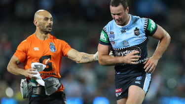 Boyd Cordner is assisted off Adelaide Oval for a head injury assessment.
