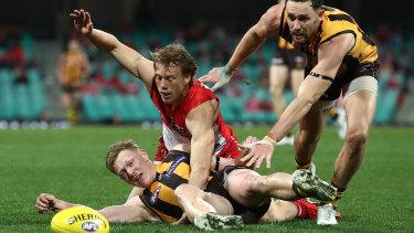 Under pressure: Sydney's Callum Mills and Hawk James Sicily compete.