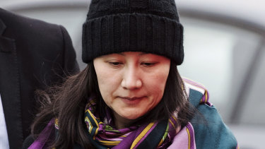 Huawei chief financial officer Meng Wanzhou arrives at a parole office with a security guard in Vancouver in December.