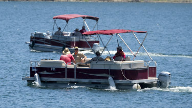 Members of the Ventura County Sheriff's Office on the lake on Monday.