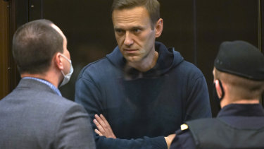 Russian opposition leader Alexei Navalny talks to one of his lawyers in court.