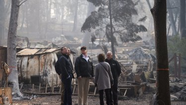 Governo-elect Gavin Newsom, FEMA Director Brock Long, President Donald Trump, Paradise mayor Jody Jones and Governor Jerry Brown tour the Skyway Villa Mobile Home and RV Park, during Trump's visit of the Camp Fire in Paradise, California on Saturday.
